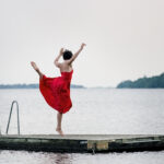 A dance series of photographies on a floating board at the sea shot with colour film